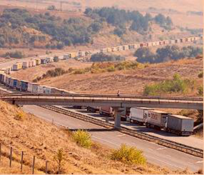 An image from the front page of the FT paper showing a queue of lorries at a Turkish border.